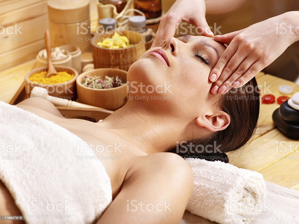Woman getting  facial massage . stock photo