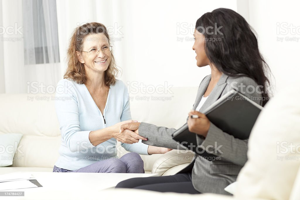 Experienced business consultant having a meeting with adult woman for...