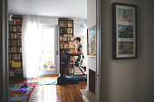 Woman getting fit and doing home training in the living room during lockdown of corona virus crises.
