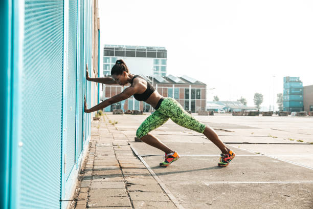 Woman getting fit in a urban setting stock photo