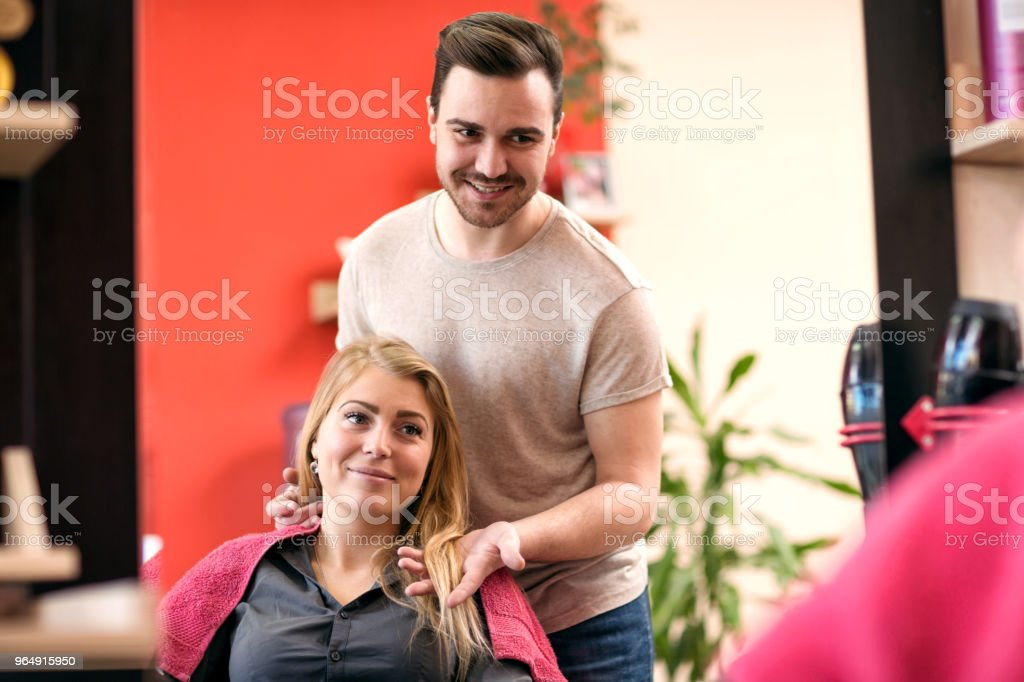 Woman getting her hair done in the beauty salon royalty-free stock photo