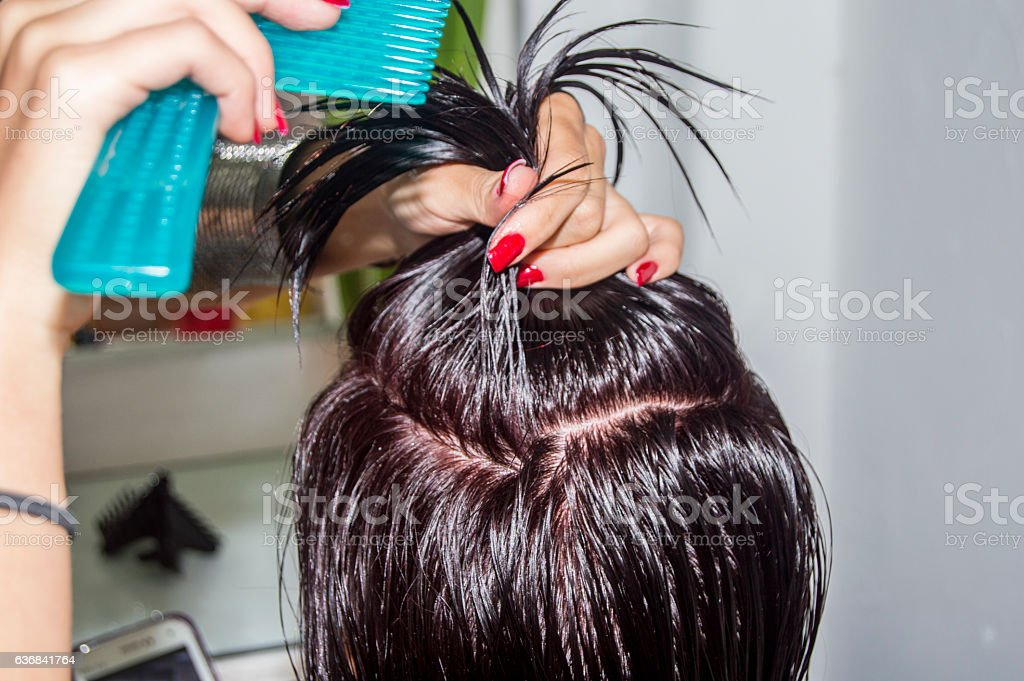 woman getting her hair styled and hair salon stock photo