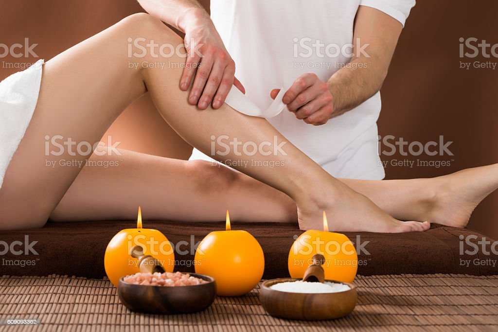 Woman Getting Her Leg Waxed stock photo