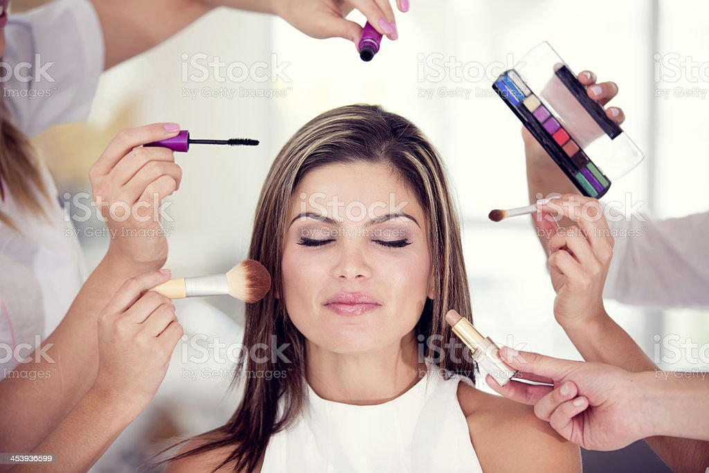 Woman getting her makeup done stock photo
