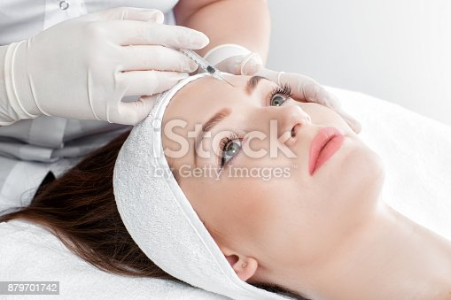 istock woman getting injection 879701742