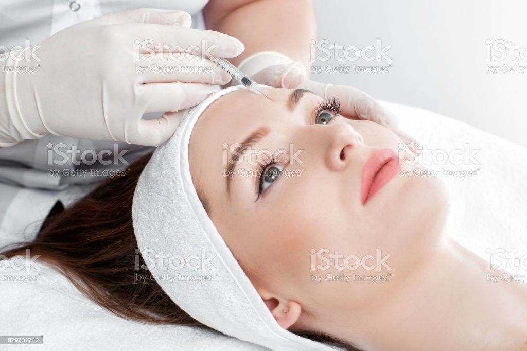 woman getting injection stock photo