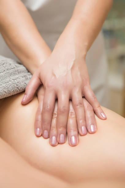 Woman getting leg massage in spa center stock photo