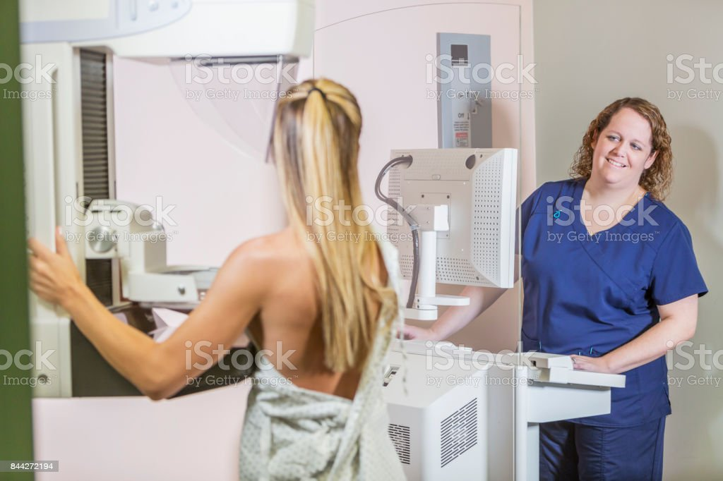 Woman getting mammogram stock photo