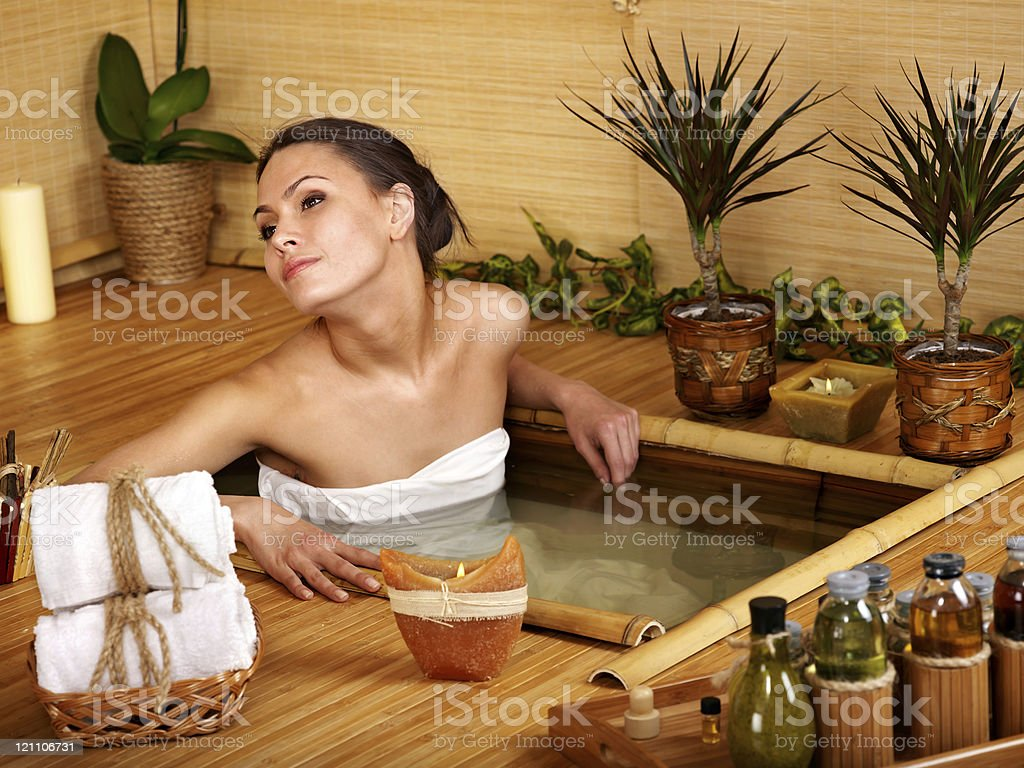 Woman getting massage in bamboo spa. royalty-free stock photo