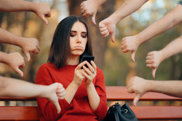 Woman Getting Negative Reactions on Social Media Post Girl suffering from cyber bullying feeling depressed critic stock pictures, royalty-free photos & images