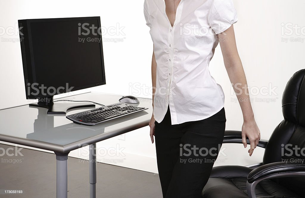 Woman getting off of chair - torso royalty-free stock photo