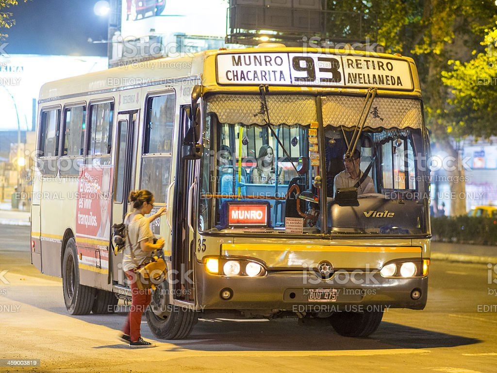 Woman getting on a city bus, Buenos Aires, Argentina royalty-free stock photo