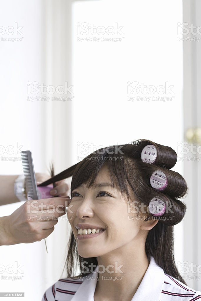 Woman getting perm stock photo