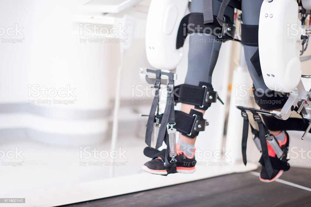 Woman getting physical therapy on a robot machine stock photo
