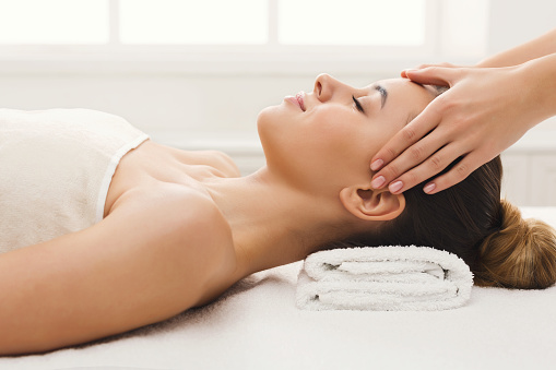 istock Woman getting professional facial massage at spa salon 936385994