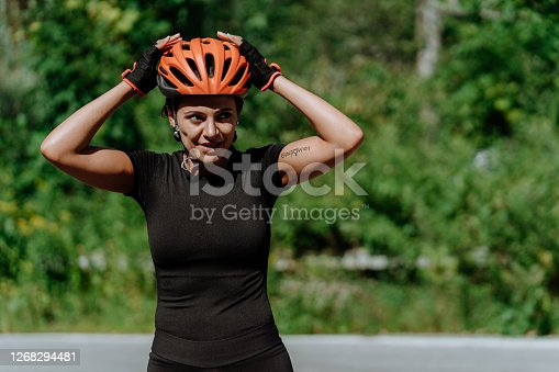 Woman getting ready for a bike ride