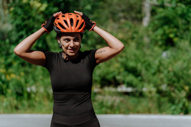 Woman getting ready for a bike ride stock photo