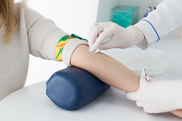a woman getting ready for a blood test - blood testing stock pictures, royalty-free photos & images