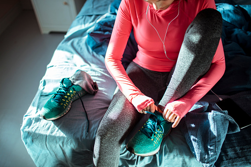 Close up of a woman getting ready for a workout