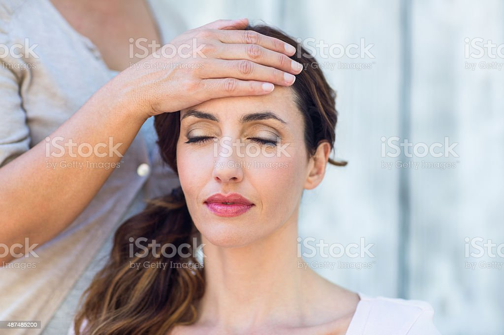 Woman getting reiki therapy stock photo
