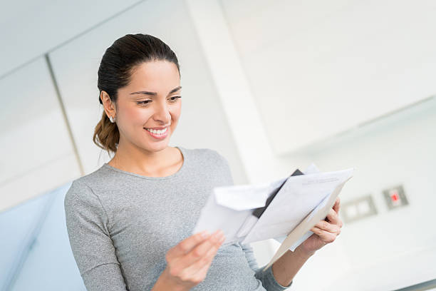 woman getting the mail - mail stock photos and pictures