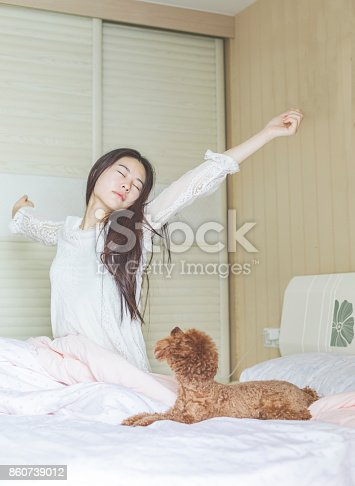 istock woman getting up while her teddy sitting on bed 860739012