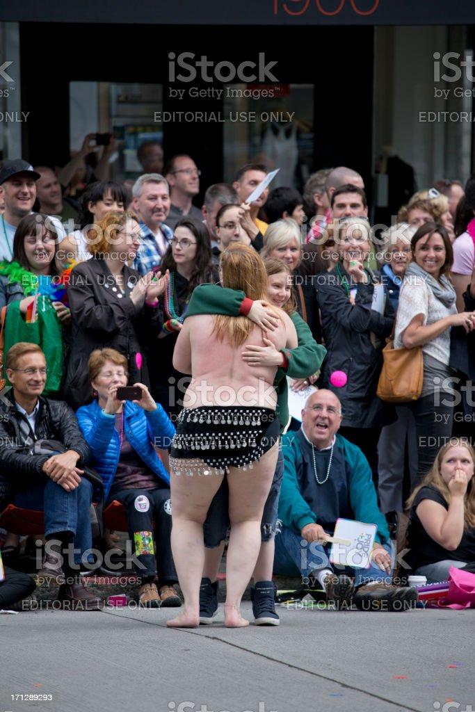 Woman gives hug at the Seattle Gay Pride Parade royalty-free stock photo