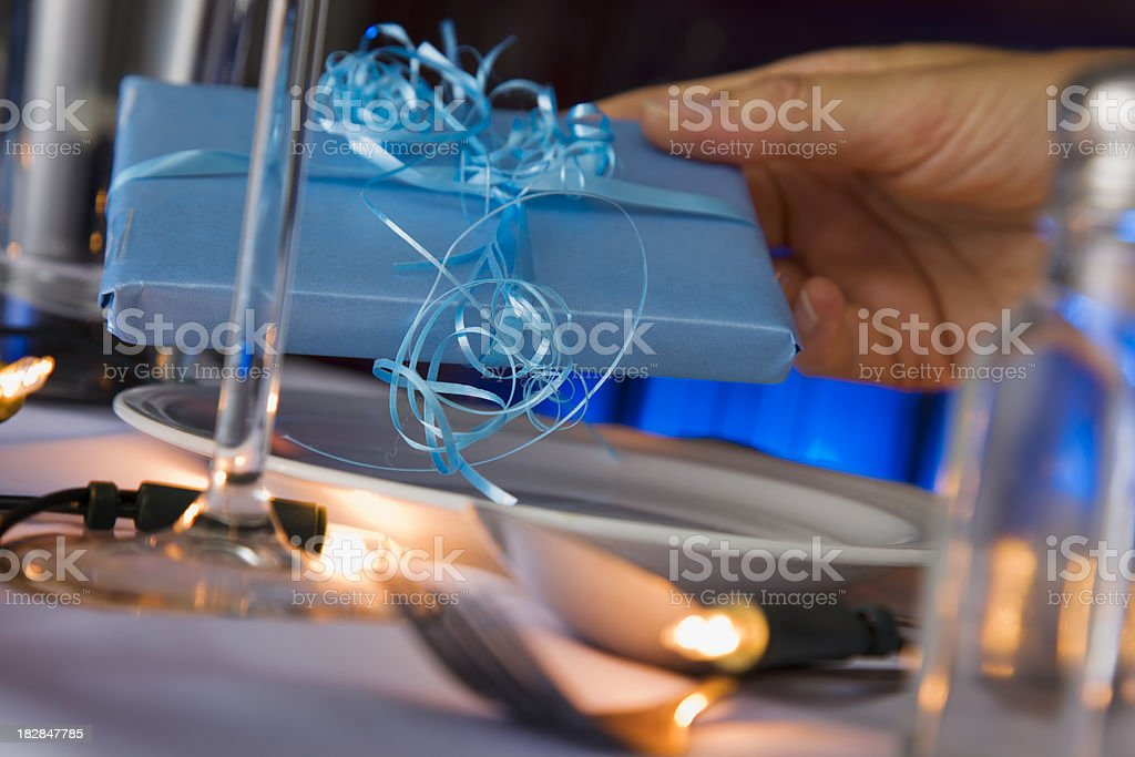 Woman Giving a Holiday Present royalty-free stock photo