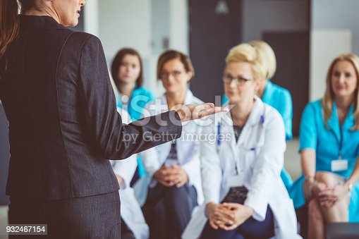 istock Woman giving a speech on seminar for doctors 932467154