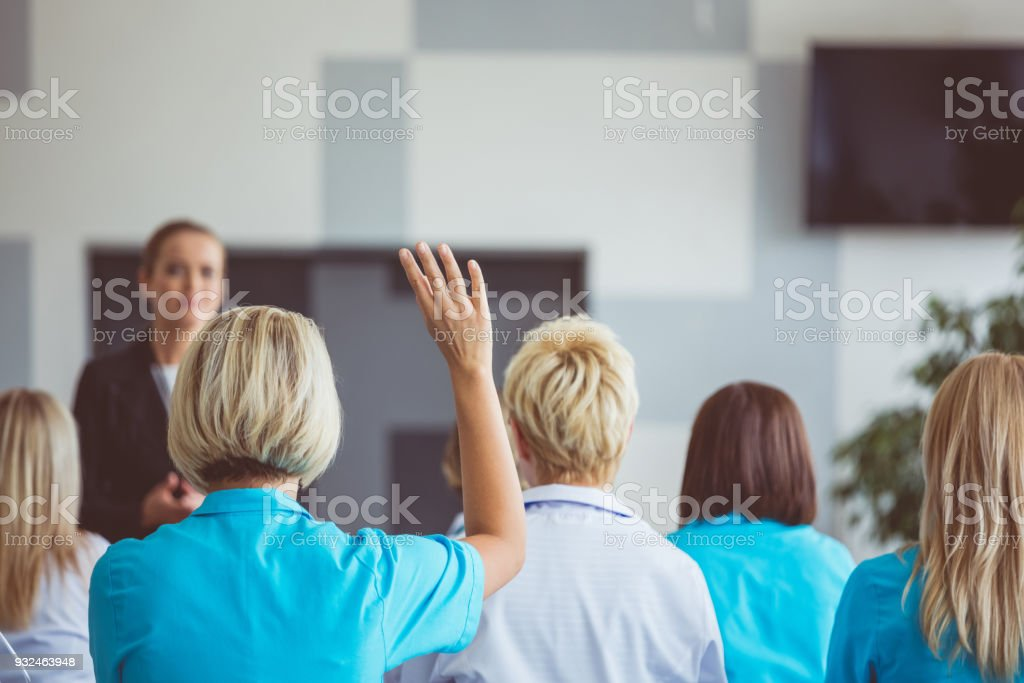 Woman giving a speech on seminar for medical staff stock photo