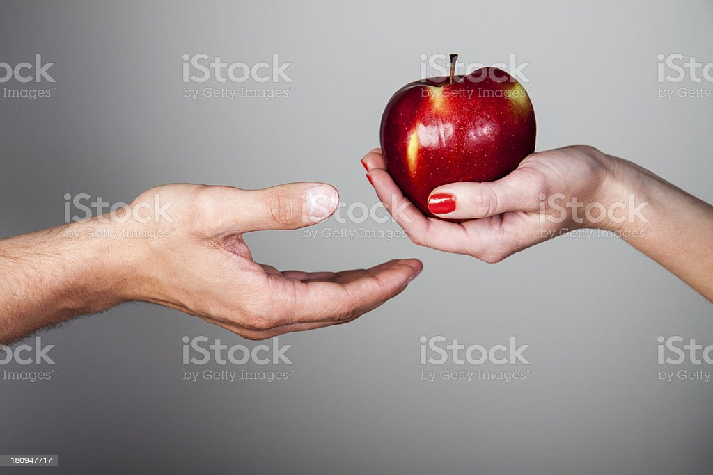 Woman giving apple stock photo