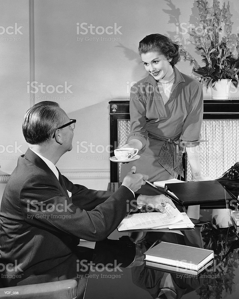 Woman giving cup to man royalty-free stock photo