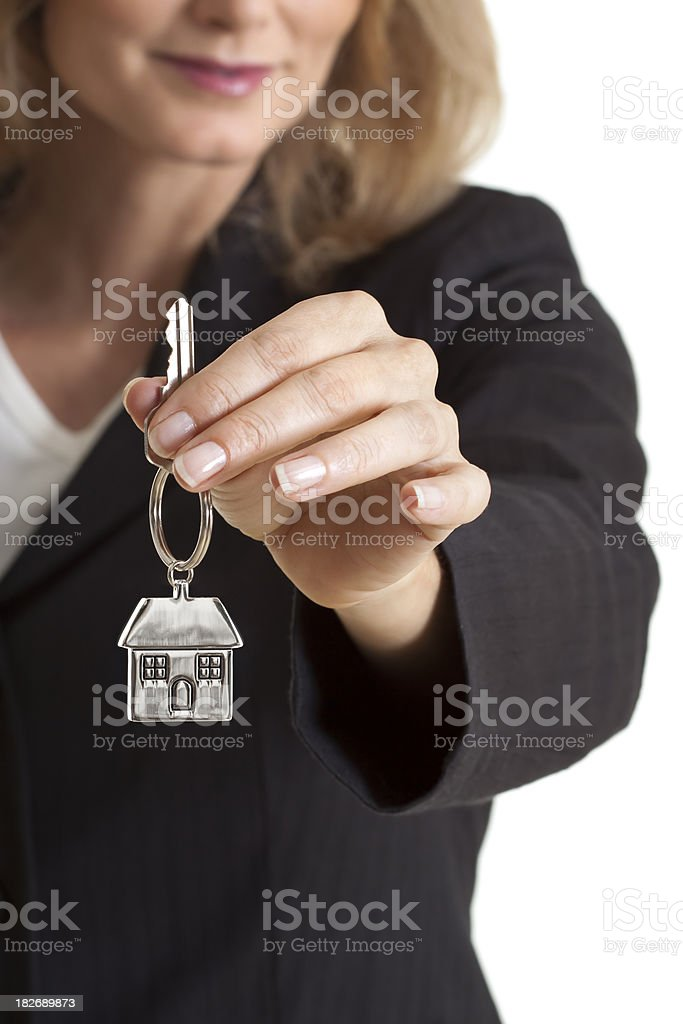 Woman giving house keys royalty-free stock photo