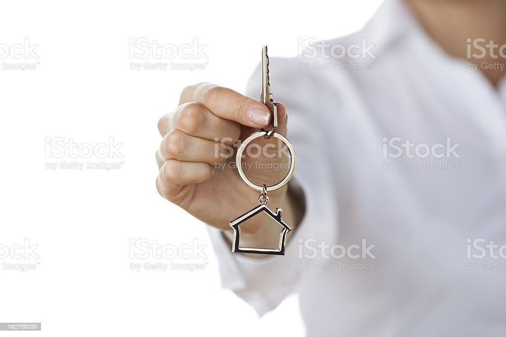 Woman giving house keys royalty-free stock photo
