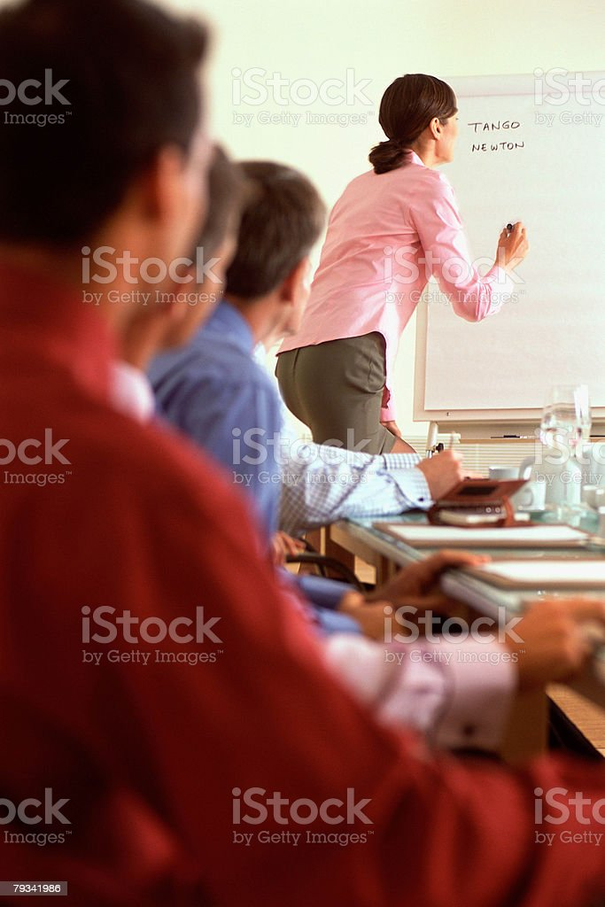 Woman giving presentation 免版稅 stock photo