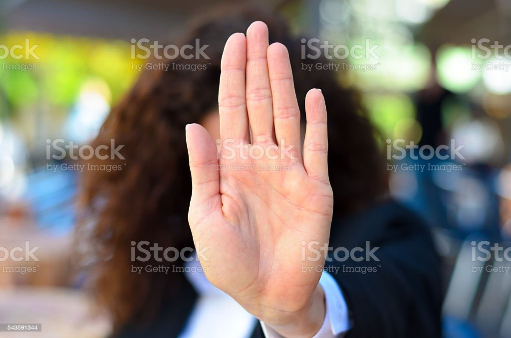 Woman giving the halt or stop sign stock photo