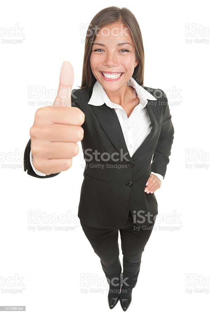 Woman giving thumbs up to the camera royalty-free stock photo