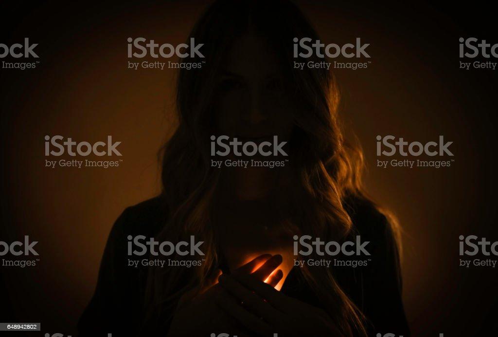Woman glowing heart stock photo