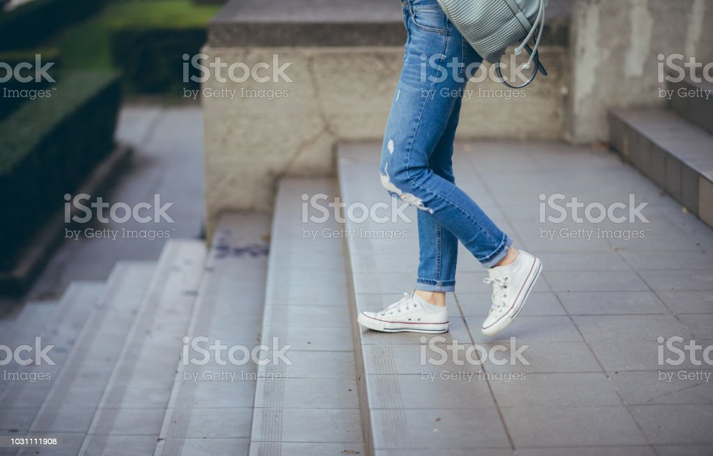 Woman going down the stairs stock photo