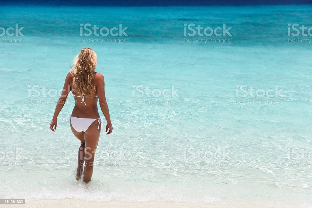woman going for a swim in the Caribbean waters stock photo