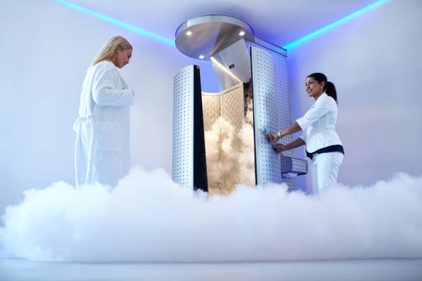 Woman going for cryotherapy treatment Portrait of woman going for cryotherapy treatment in cryosauna booth. cryotherapy stock pictures, royalty-free photos & images