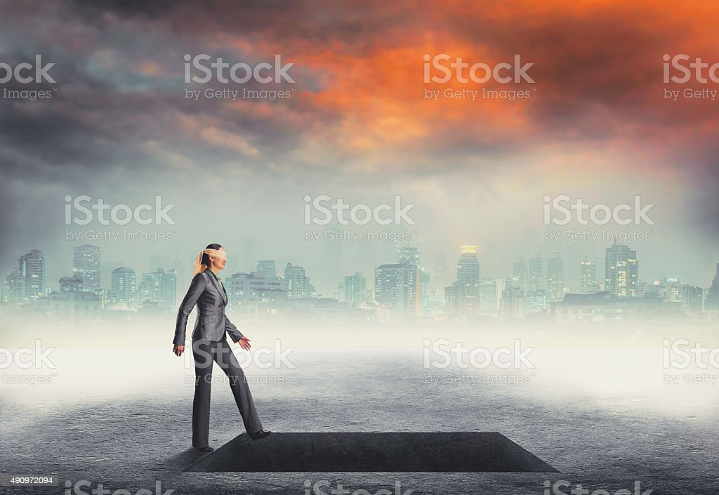 Woman going to a deep pit stock photo