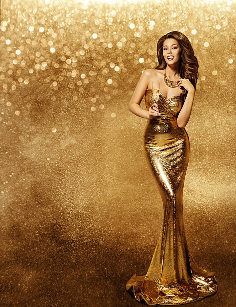 woman gold dress, fashion model with champagne long golden gown - soirées habillées photos et images de collection