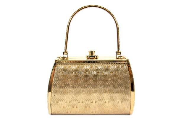Woman gold handbag isolated on white background.Gold handbag isolated stock photo