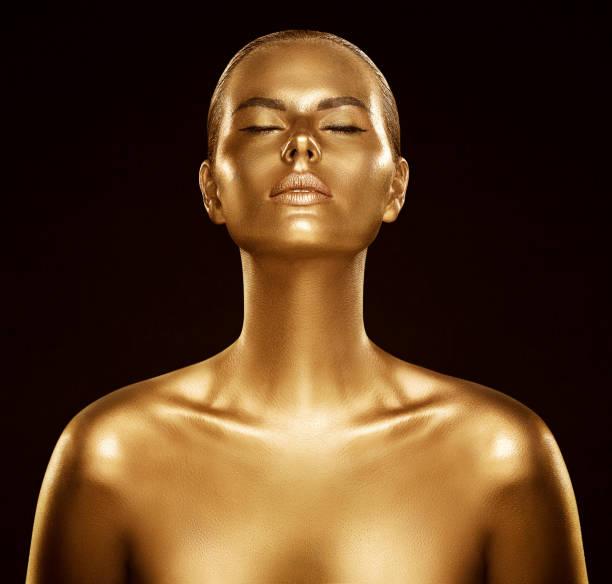 Woman Gold Skin, Fashion Model Golden Body Art, Beauty Portrait Face and Body Shine as Metal stock photo