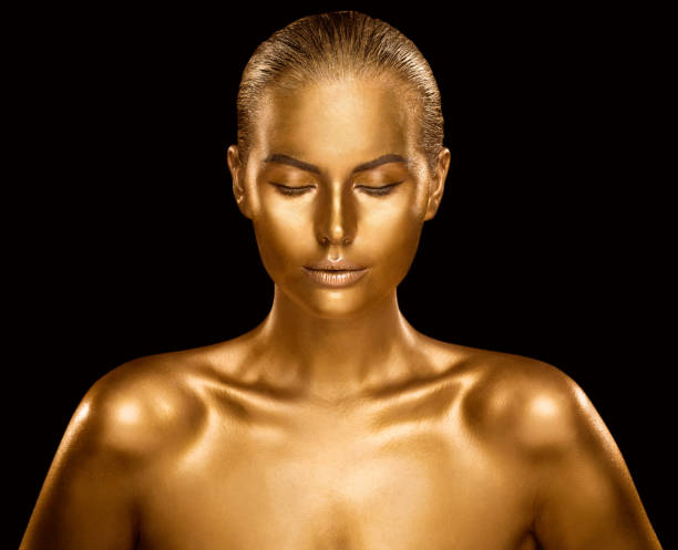 Woman Golden Skin, Fashion Model Painted Gold Body Art, Beauty Makeup as Bronze Metal stock photo