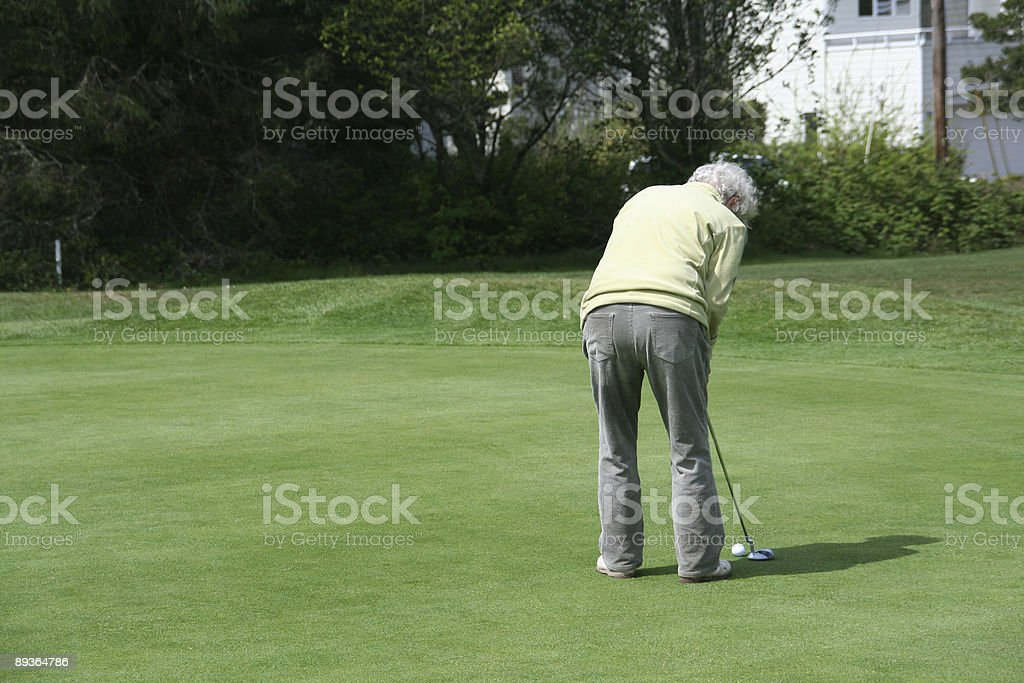 Donna Golf sul green foto stock royalty-free