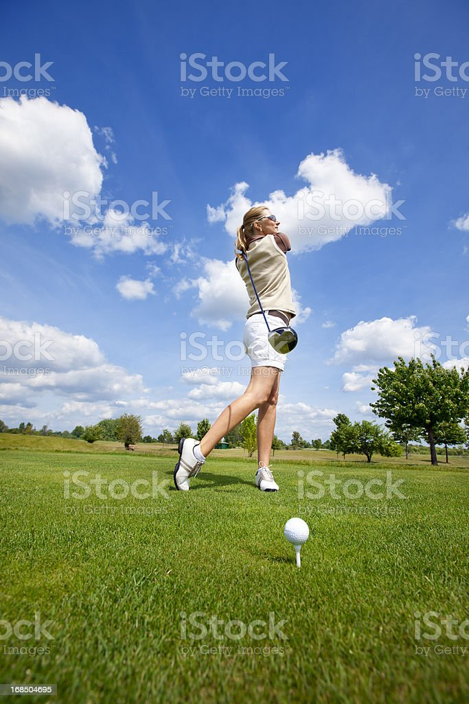 Woman Golfer taking a good golf swing royalty-free stock photo
