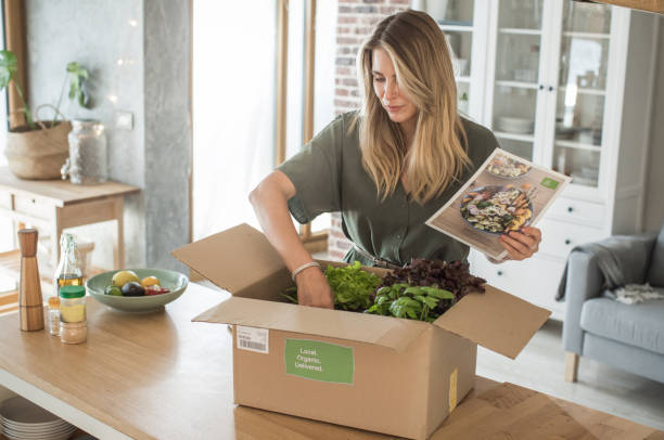 woman got package from meal delivery service. - food delivery imagens e fotografias de stock