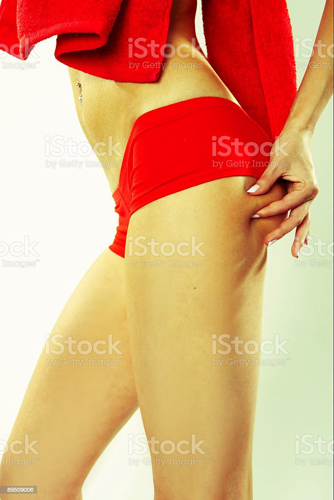 Woman Grabbing at Her Buttocks royalty-free stock photo
